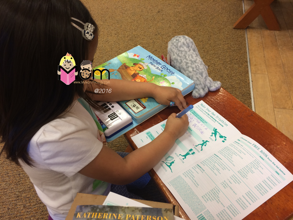 Filling out her B&N summer form for a free book.